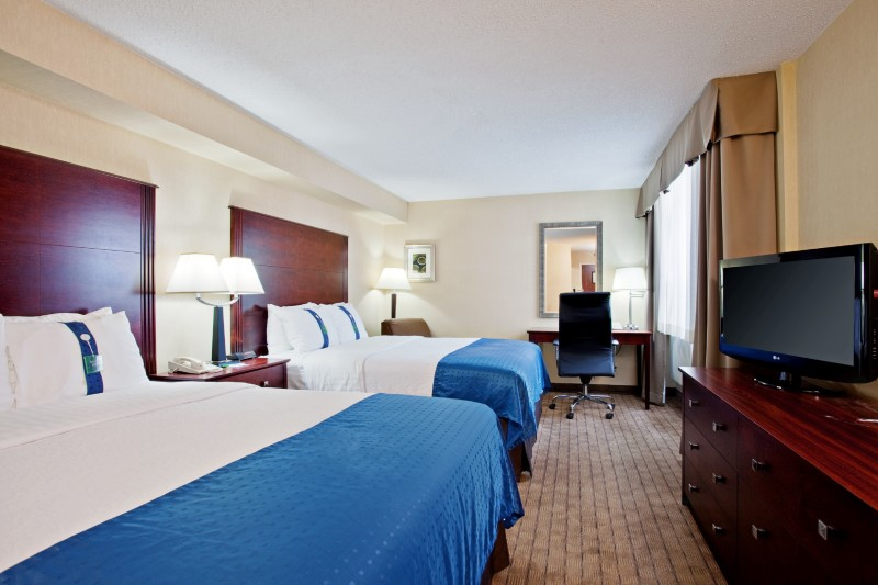 Spacious two doubles or two queens guestrooms with triple sheeted bedding, pillow menu (soft & firm), 37'HD TV, large business desk, Free WIFI, coffee maker, hairdryer and ironing board.