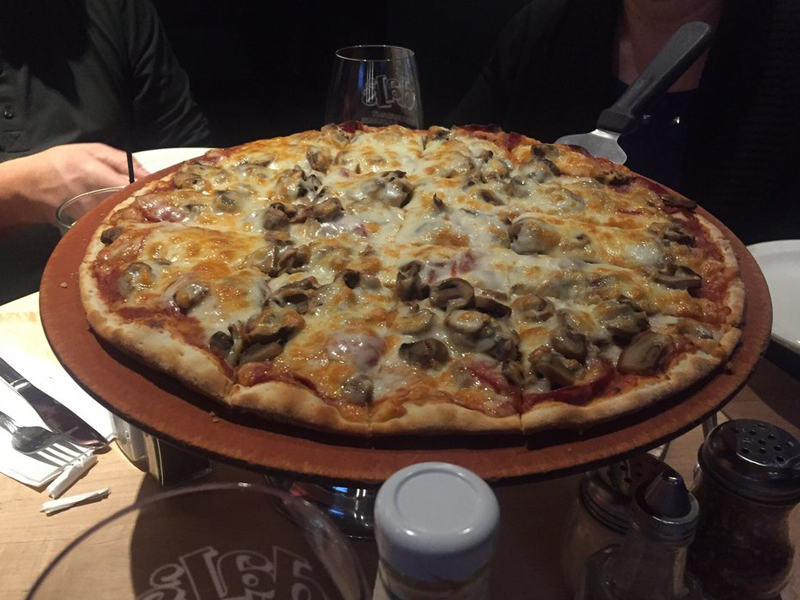 Pepperoni and mushroom pizza by Lucia L., Yelp