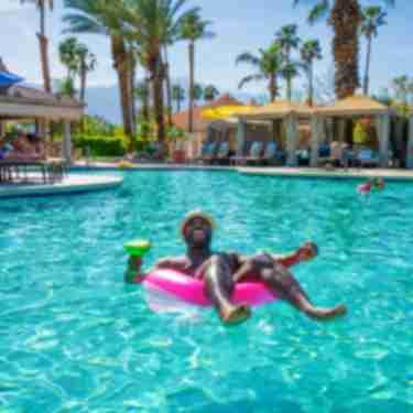 Man in pool float
