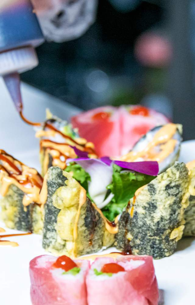 A plate of sushi being prepared at Woochi Japanese Fusion & Bar