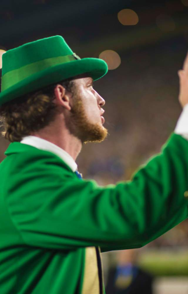 The Notre Dame Leprechaun cheering for the football team