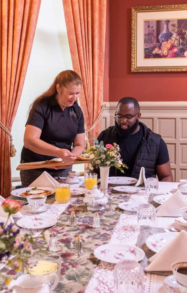 A couple is given their breakfast at the Oliver Inn Bed and Breakfast in South Bend
