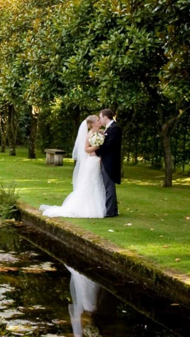 A man and woman getting married at Athelhampton House in Dorset