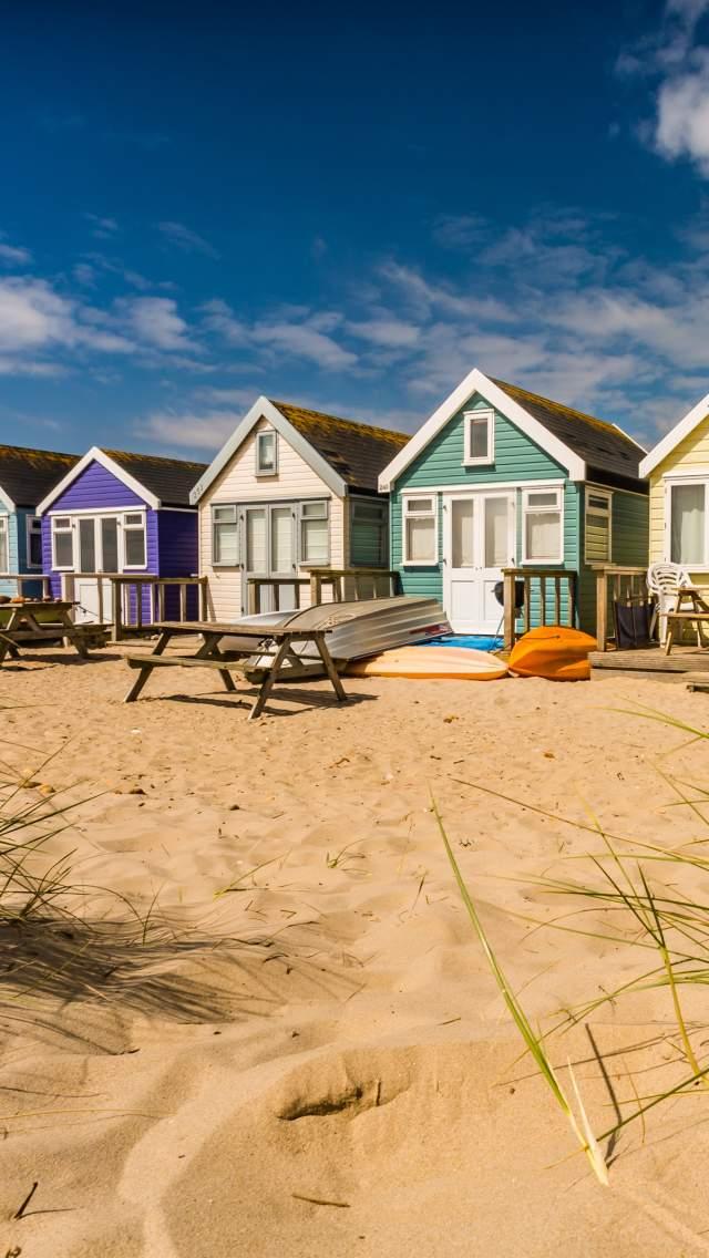 Colourful beach huts at Mudeford Sandbank, Dorset