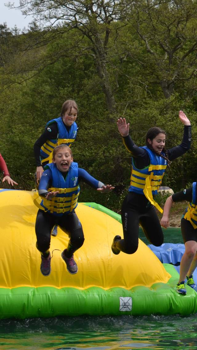 Group of people on the inflatables at Dorset Adventure Park