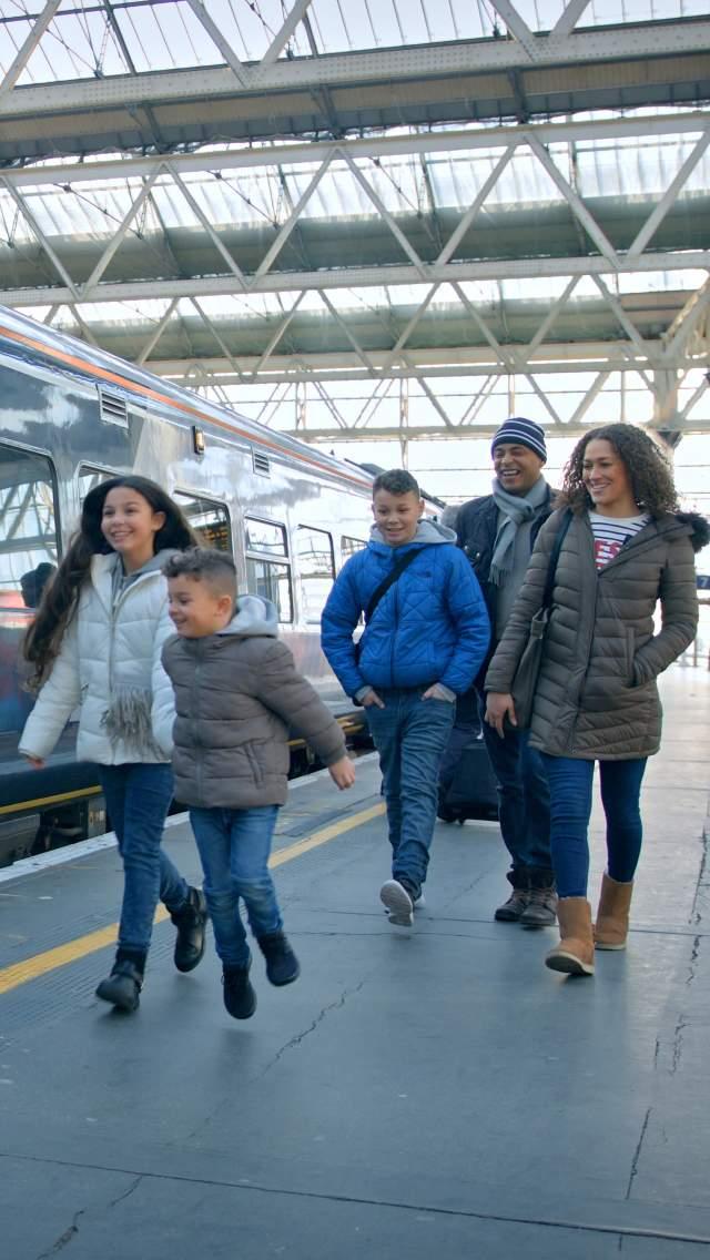 Family boarding South Western Railway train