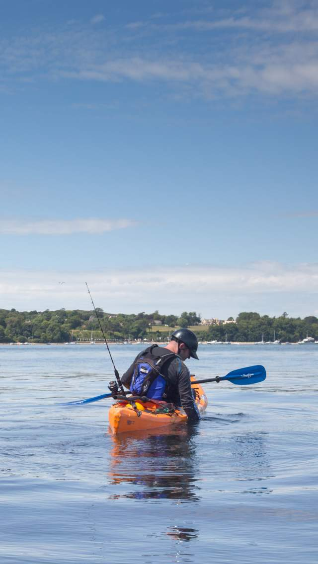 A sea Kayaker fishing near Old Harry Rocks