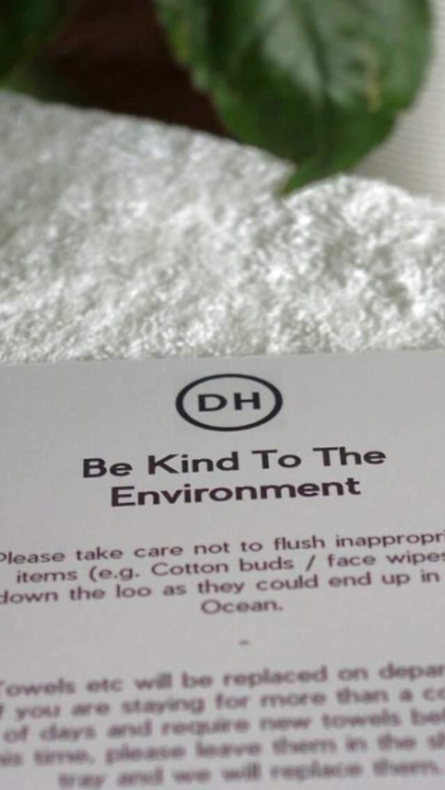 Eco-friendly notice in hotel bathroom at Dorset House in Lyme Regis