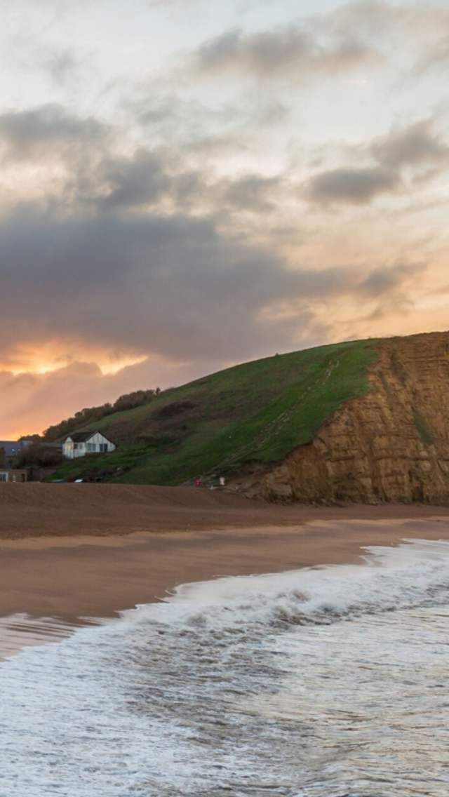 Beach at West Bay with the cliffs in the background