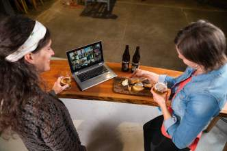 Two women host a virtual beer and cheese tasting