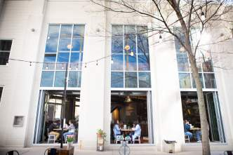 Couples dine in an open-air restaurant in Madison
