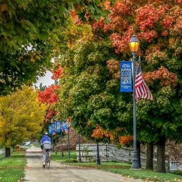 Cyclist on Bike Trail in Fall