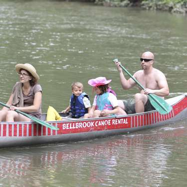Family paddling the Little Miami River at Bellbrook Canoe Rental