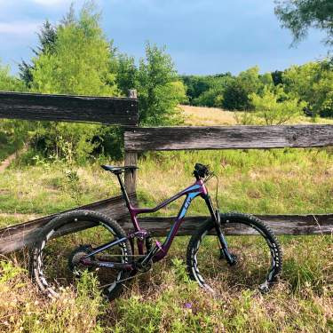 Biking leaning up against fence at the Frisco Mountain Bike Trail