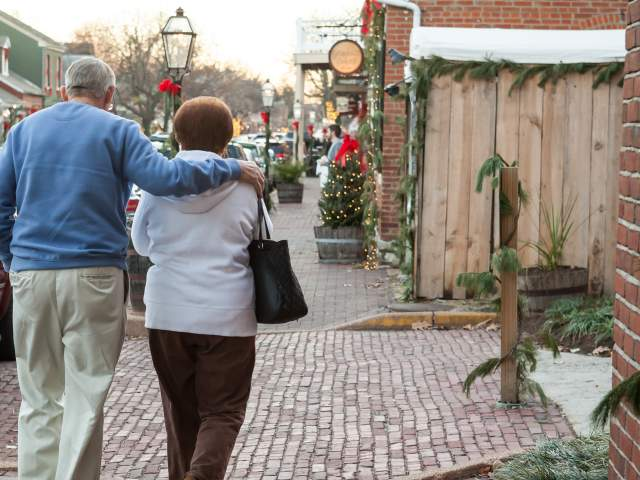 Couple walking holiday decorated Main Street in St Charles