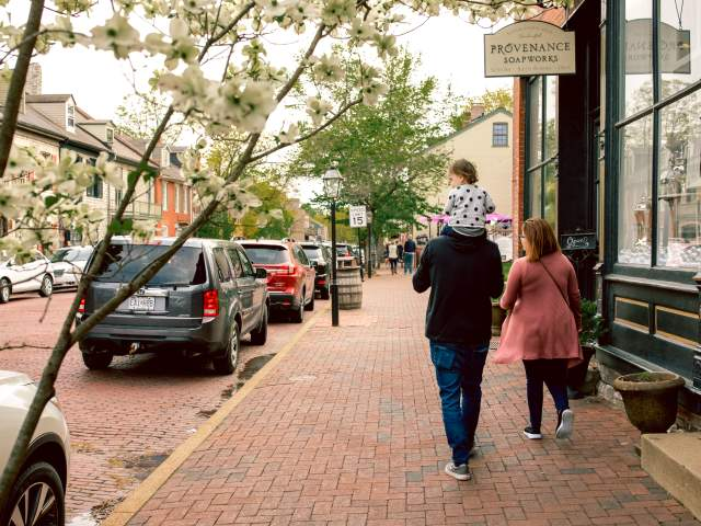 Small family strolling down Main Street St. Charles