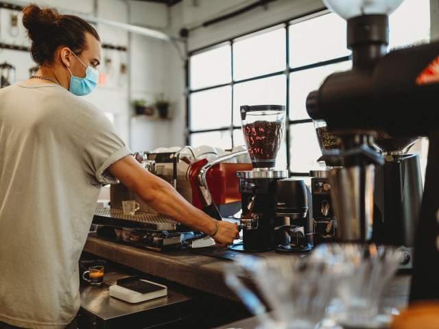 Barista making coffee at Upshot Coffeehouse
