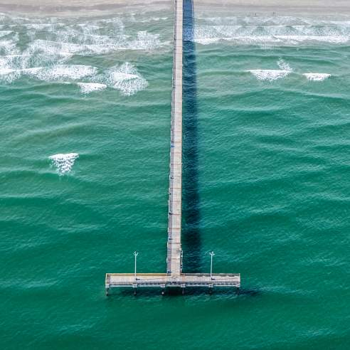 Aerial view of the Horace Caldwell pier at the beach
