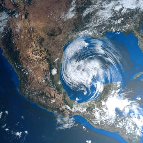 Satellite image of a hurricane that looks like a white vortex approaching the Gulf Coast of the United States and Mexico
