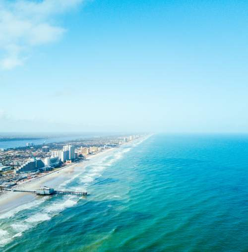 aerial view of daytona beach that includes the city and ocean
