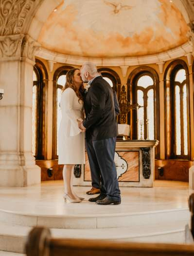 Bride and groom kissing on the altar at the Bella Donna Chapel
