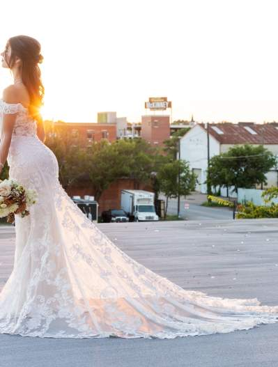Bride standing atop the Mill at East Mckinney looking toward downtown McKinney