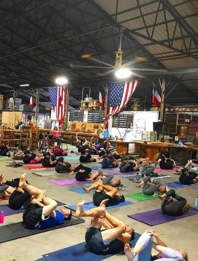People doing yoga on the floor of TUPPS Brewery