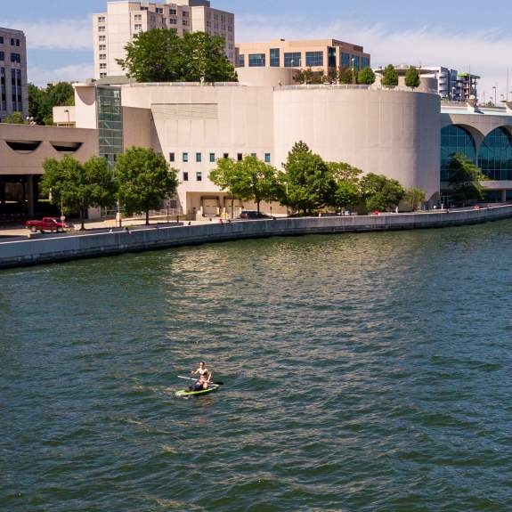 Paddlers on Lake Monona, looking at the Monona Terrace in Madison, WI