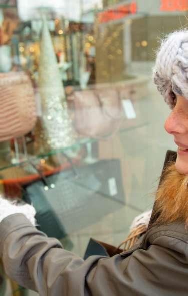 A girl smiles as she window shops