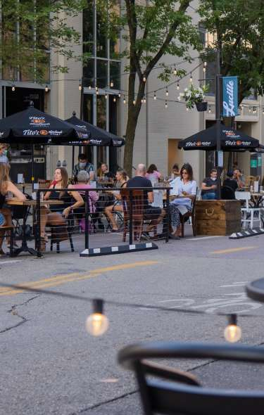 People dine at streateries in downtown Madison