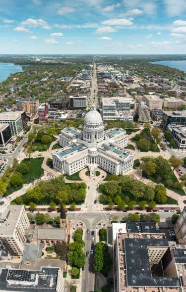 An aerial view of the State Capitol with the isthmus stretching behind it.