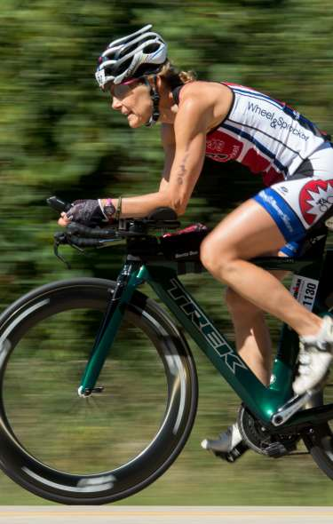 A woman rides her bike during the IRONMAN competition