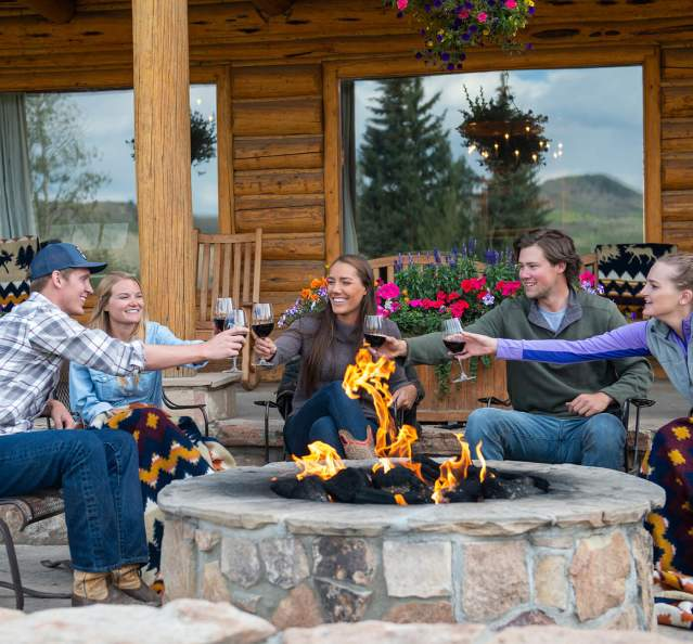 Group of people dining outside at C Lazy U Ranch
