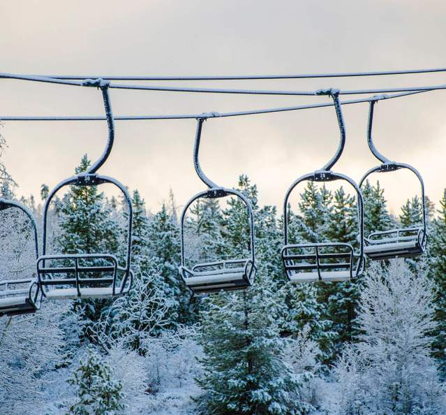 Snowy chairlifts at Granby Ranch