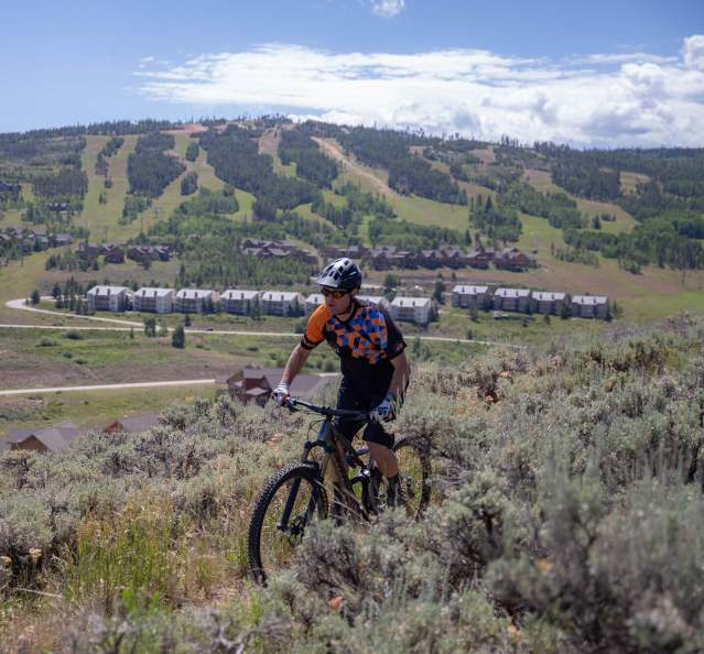 Mountain biking with Granby Ranch in the background