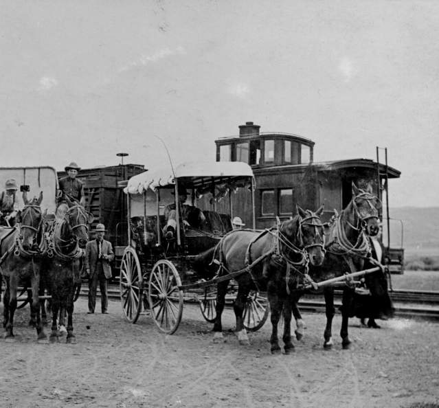 Historic photo of carriages in front of train in Granby