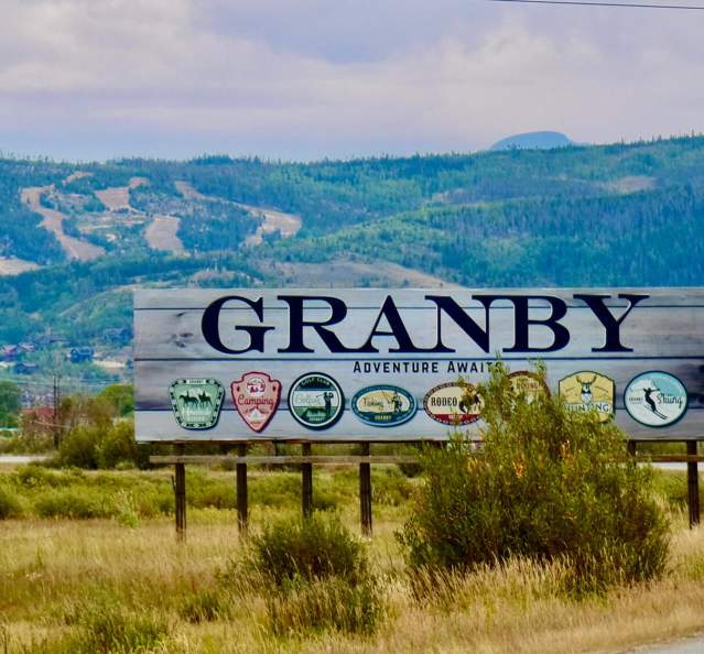 Billboard outside of Granby with Granby Ranch in the background