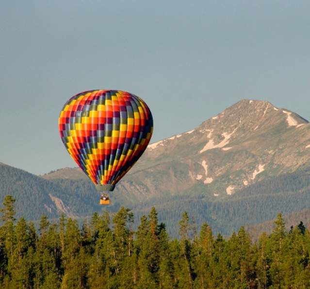 Hot air balloon with view of Byers Peak