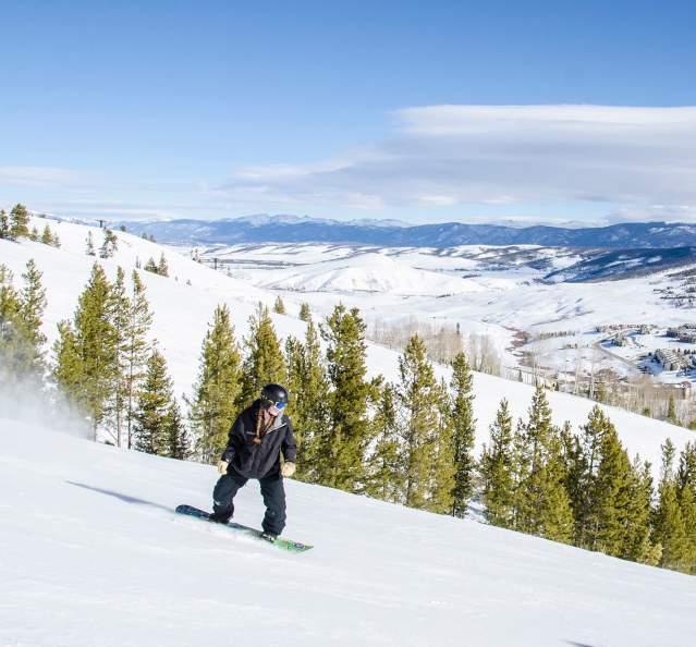 Woman snowboarding at Granby Ranch