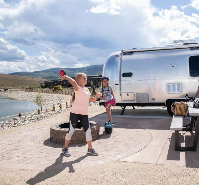 Kids playing in front of Airstream at River Run RV Resort