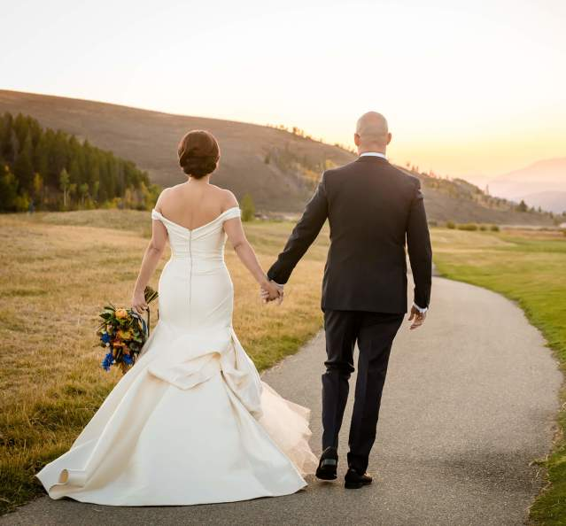 Couple wedding photo on golf course at Granby Ranch