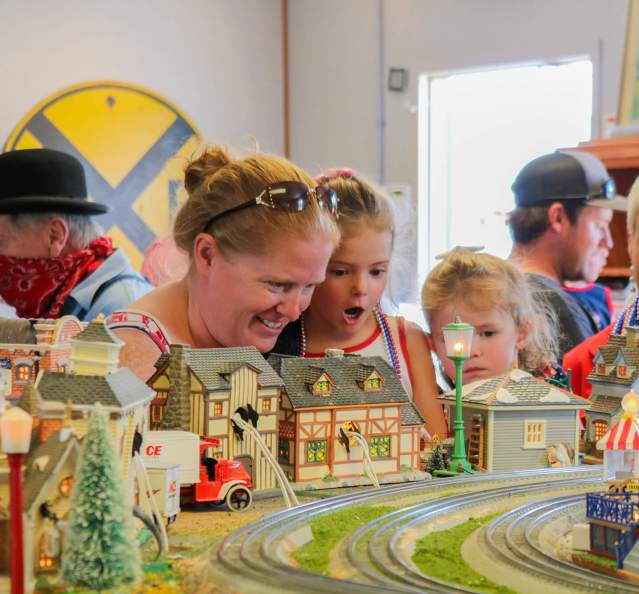 Parents and kids enjoying the Moffat Road Railroad Museum