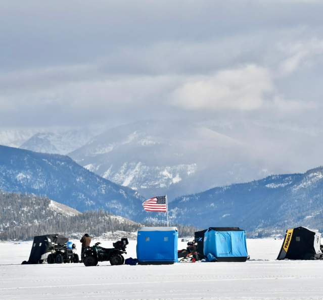 View of tents and snowmobiles at 3 Lakes Ice Fishing Contest