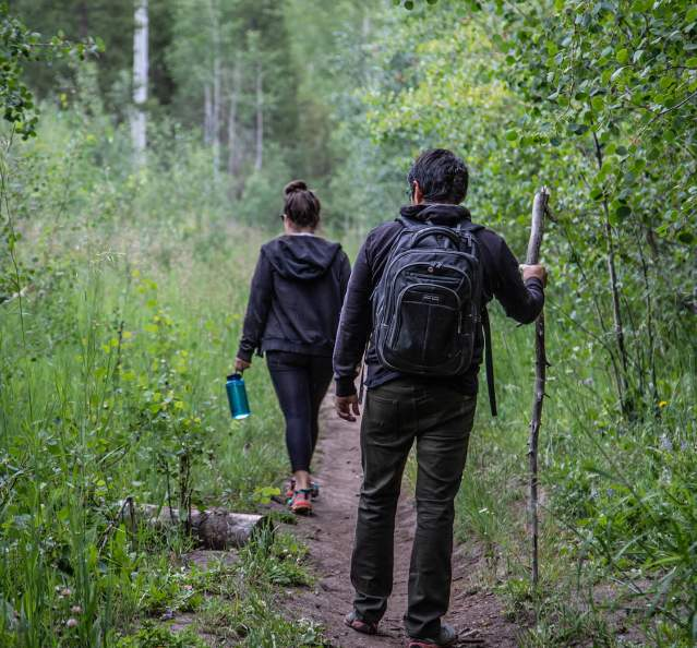 Couple hiking on a forested trail