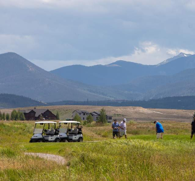Golfing at Grand Elk with mountains in the background