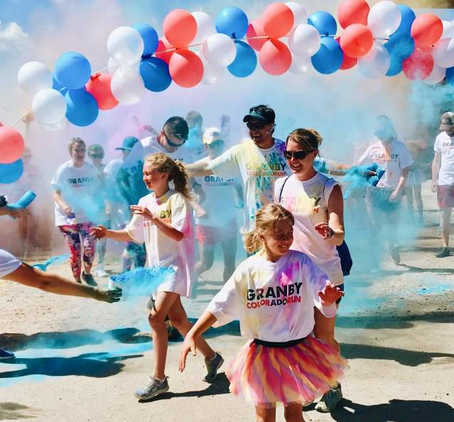 Family at the start line of the Granby 5K Color Run