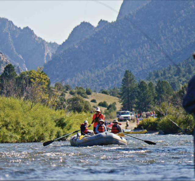 Rafting on the Colorado River with a fisherman in the foreground