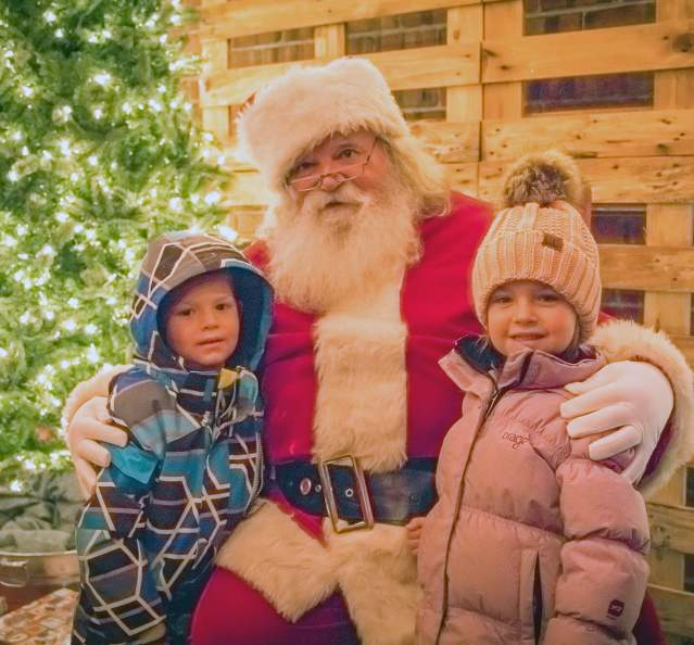 Santa and kids at holiday event