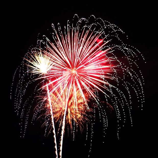 Pink and Orange Fireworks exploding in the sky