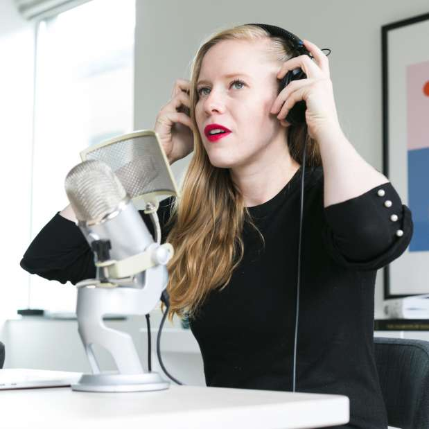 woman adjusting mic